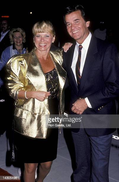 Dick Clark and wife Kari Clark attend memorial service for Neil Bogart on December 4 1985 at the Hollywood Park in Hollywood California