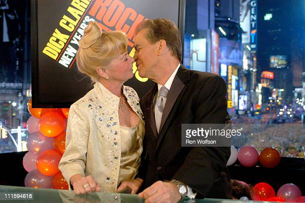 Dick Clark plants his traditional New Year's kiss on his wife Kari Clark just after his countdown to midnight during his annual New Year's Rockin'...
