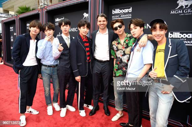 Dick Clark Productions CEO Mike Mahan poses with musical group BTS at the 2018 Billboard Music Awards at MGM Grand Garden Arena on May 20 2018 in Las...