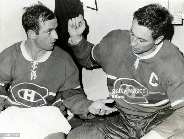 Dick Duff and Jean Beliveau of the Montreal Canadiens celebrate in the locker room after they scored the only two goal for the Canadiens during Game...