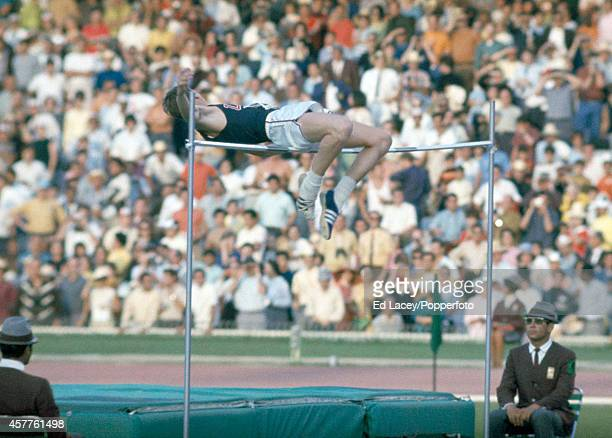 Dick Fosbury employing the Fosbury Flop to win the gold medal in the men's high jump event during the Summer Olympic Games in Mexico City circa...