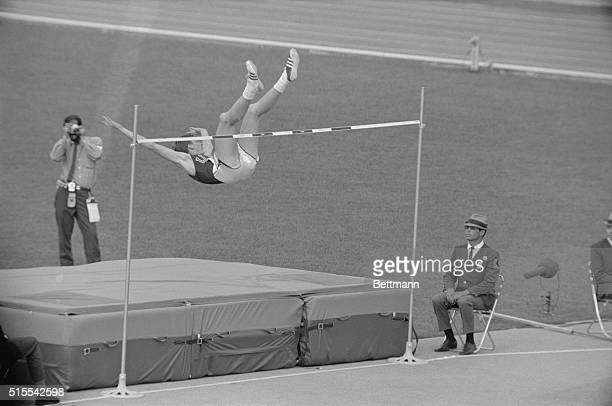 Dick Fosbury of Medford Oregon the high jumper who goes over the bar backwards is shown in his unorthodox manner during the Olympic high jump...