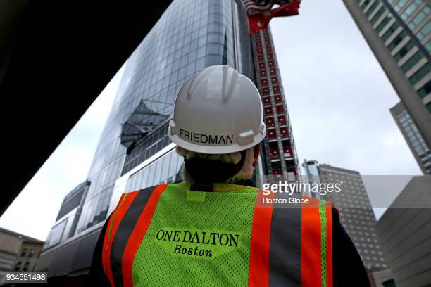 Dick Friedman developer at the underconstruction One Dalton in Boston looks up at the crane at work on the building on March 9 2018 Under...
