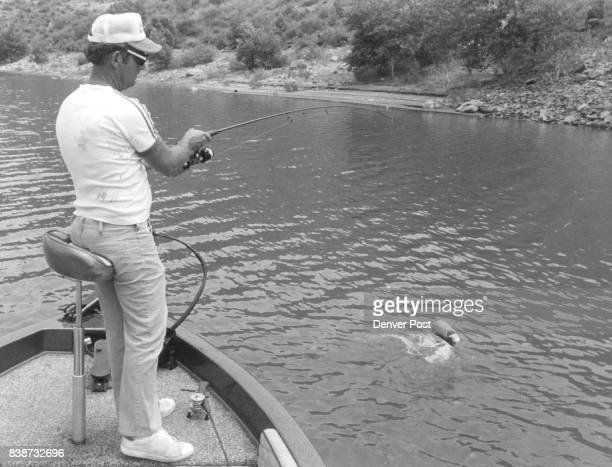 Dick Gasaway hangs on to a jumping largemouth bass caught on plastic grub at Horsetooth reservoir Credit Denver Post