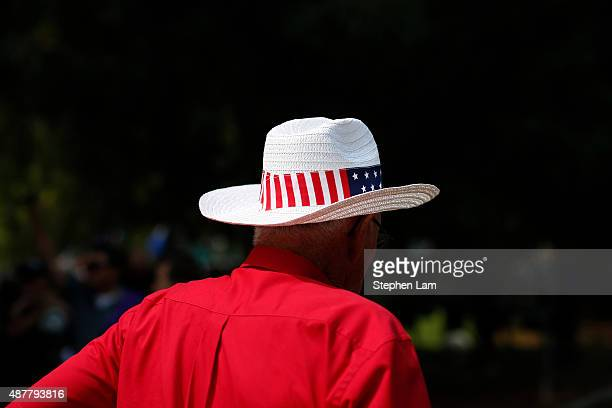 Dick Gould a road crew member with the California Automobile Museum wears a American flagthemed hat before participating in a parade honoring Alek...