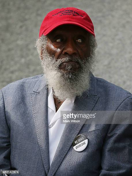 Dick Gregory attends a rally at the Dr. Martin Luther King Jr. Memorial during a rally to commemorate the 50th anniversary of the Voting Rights Act,...