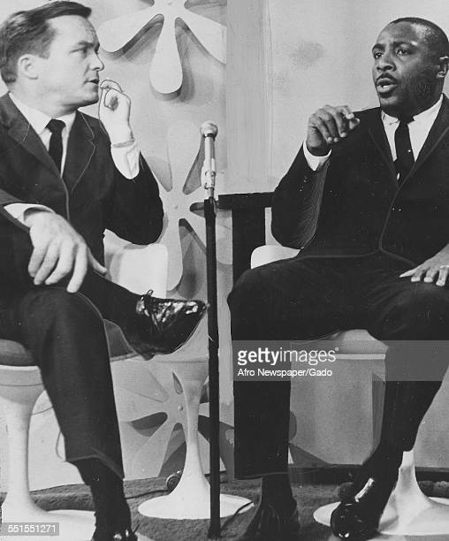 Dick Gregory comedian and civil rights campaigner answering Mike Douglas questions on a television talk show January 23 1965