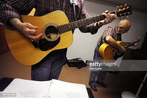Dick Greunke right plays his guitar in a side room in the basement of his church Saturday September 19 2009 The Old Country Church in Lakewood...