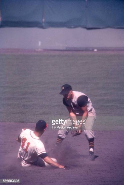 Dick Groat of the Pittsburgh Pirates tries to tag out Eddie Mathews of the Milwaukee Braves during an MLB game on July 4 1960 at Milwaukee County...