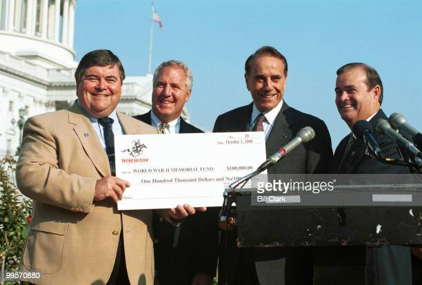 Dick Hammett Vice President Marketing for Winchester Ammunition presents a check for $100000 to fmr Sen Bob Dole as a donation for the building of...