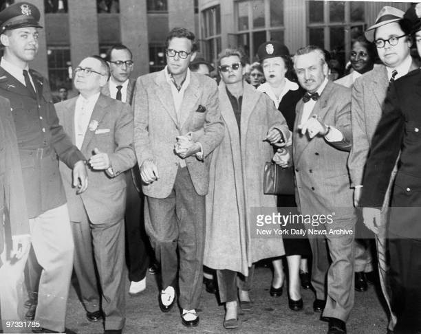 Dick Haymes and Rita Hayworth walk out of courthouse after hearings for custody of her children