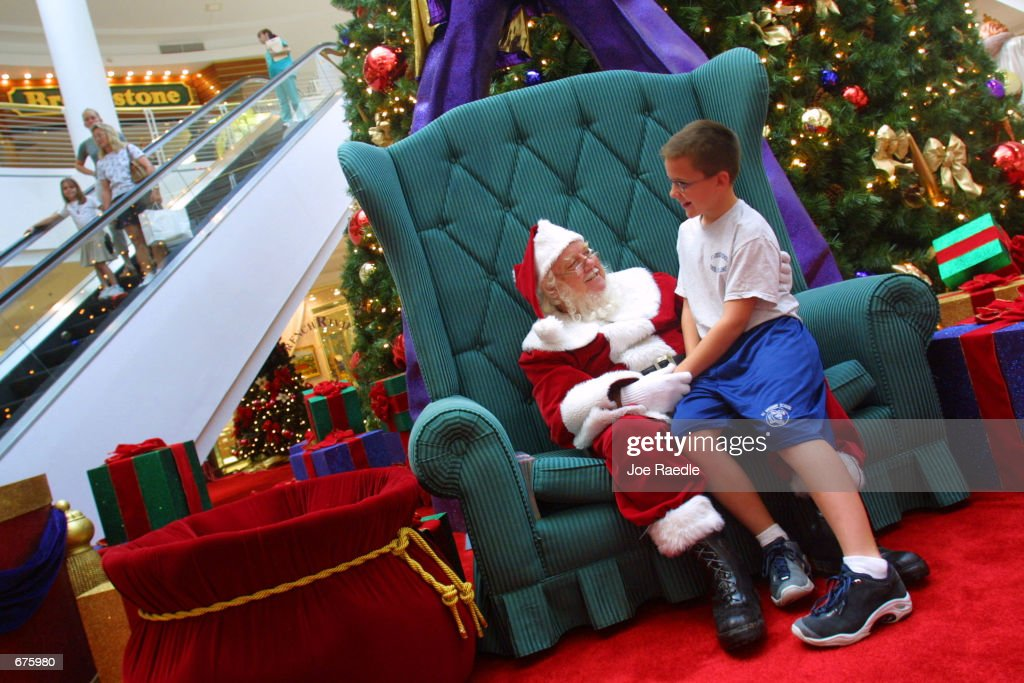 Dick Johnson dressed as Santa Claus listens to John Mahoney December