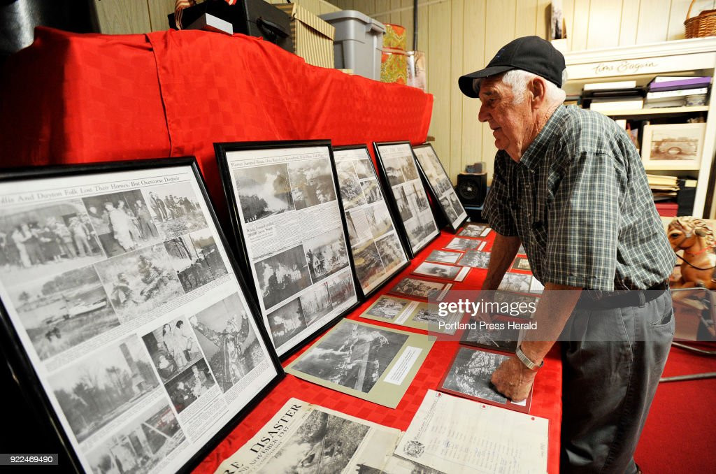Dick Neal who helped fight the 1947 Maine fires as a teenager looks over newspaper articles about the fire at the Acton-Shapleigh Historical Society Thursday, September 28, 2017.