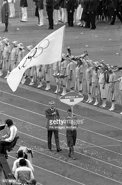 Dick Palmer Great Britain's Chef de Mission and sole representative in the opening ceremony carries the Olympic flag around the Olympic Stadium