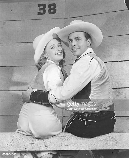Dick Powell stars as Elly Jordan with costar Priscilla Lane as Jane Hardy in the musical comedy Cowboy from Brooklyn