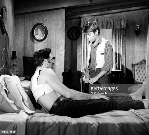 Dick Powells Zane Grey Theater production of the episode Rebel Ranger featuring from left Scott Forbes and Don Grady Image dated October 16 1959...