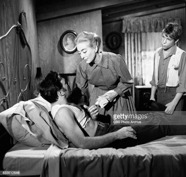 Dick Powells Zane Grey Theater production of the episode Rebel Ranger featuring from left Scott Forbes Joan Crawford and Don Grady Image dated...