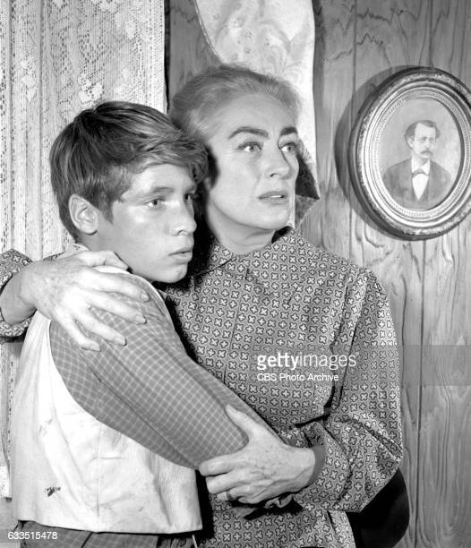Dick Powells Zane Grey Theater production of the episode Rebel Ranger featuring from left Don Grady and Joan Crawford Image dated October 16 1959...