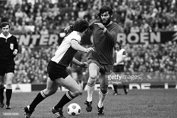 Dick Schneider of Feyenoord Barry Hulshoff of Ajax during the Dutch Eredivisie match between Feyenoord and Ajax Amsterdam on october 27 1974 in...