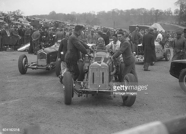 Dick Seaman's ERA Dick Shuttleworth's Alfa Romeo and a MG Magnette at Donington Park 1935 Artist Bill BrunellERA 1488S cc Entry No 11 Driver Seaman...