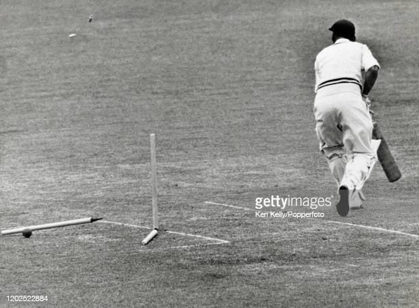 Dick Spooner of Warwickshire is bowled for 8 runs by Jack Flavell of Worcestershire during the County Championship match between Worcestershire and...