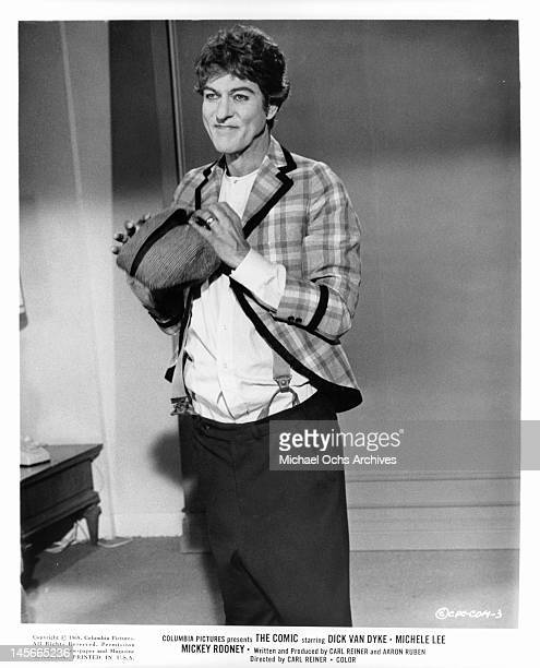 Dick Van Dyke dressed in clown clothes without makeup on in a scene from the film 'The Comic' 1969