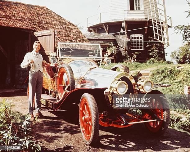 Dick Van Dyke posing beside the car in a publicity portrait issued for the film 'Chitty Chitty Bang Bang' United Kingdom 1968 The 1968 musical...