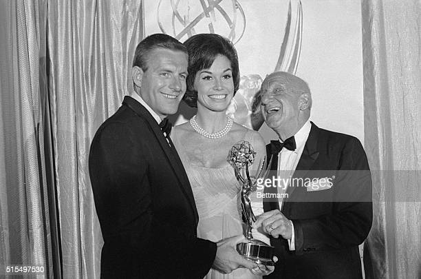 Dick Van Dyke's brother Jerry and his costars from the television series Mary Tyler Moore accept Dick's Emmy Award here September 12 from Jimmy...