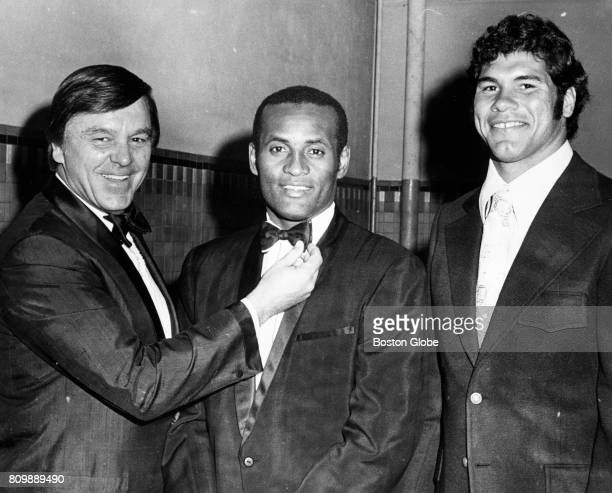 Dick Williams Roberto Clemente and Jim Plunkett pose for a photo at the annual baseball dinner in Manchester NH on Jan 19 1972