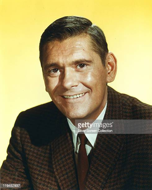 Dick York US actor posing against a yellow background in a publicity portrait issued for the US television series 'Bewitched' USA circa 1967 The...