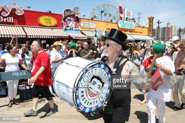 Dick Zigun marches during the 2018 Coney Island Mermaid Parade on June 16 2018 in New York City