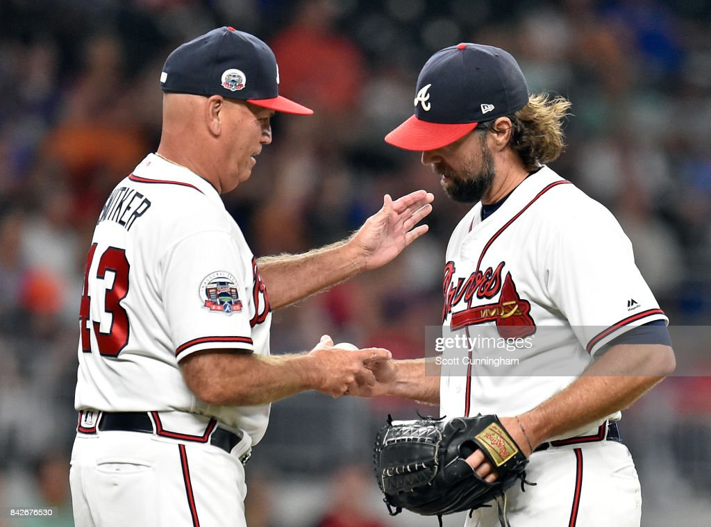 R. A. Dickey #19 of the Atlanta Braves is removed from the game by Manager Brian Snitker #43 during the fifth inning against the Texas Rangers at SunTrust Park on September 4, 2017 in Atlanta, Georgia.