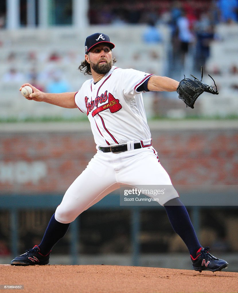 R. A. Dickey #19 of the Atlanta Braves throws a first-inning pitch against the Washington Nationals at SunTrust Park on April 20, 2017 in Atlanta, Georgia.