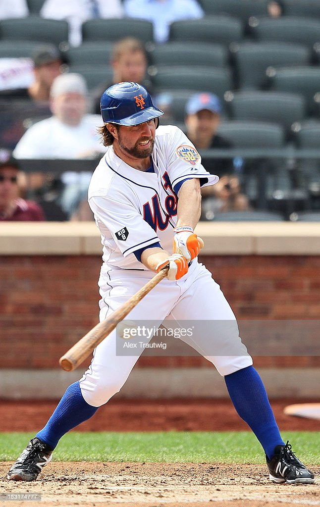 R.A. Dickey #43 of the New York Mets bats against the Pittsburgh Pirates at Citi Field on September 27, 2012 in the Flushing neighborhood of the Queens borough of New York City.