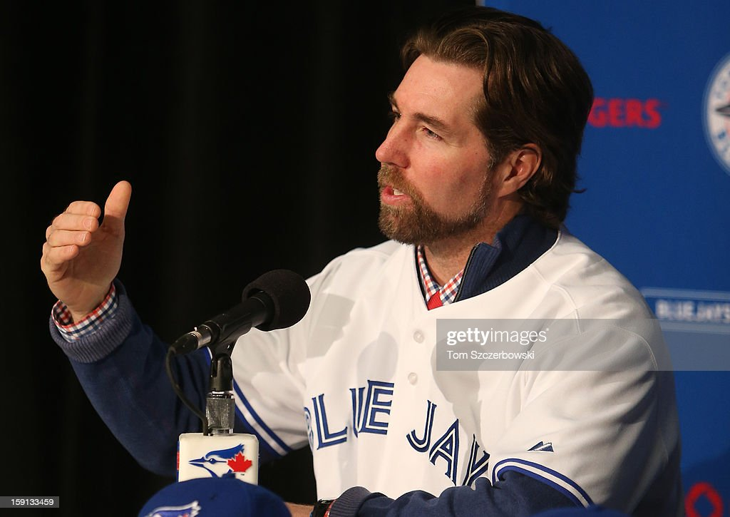 R.A. Dickey #43 of the Toronto Blue Jays answers questions from the media as he is introduced at a press conference at Rogers Centre on January 8, 2013 in Toronto, Ontario, Canada.