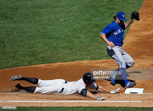 A Dickey of the Toronto Blue Jays beats Brett Gardner of the New York Yankees to first base for the out in the third inning at Yankee Stadium on...