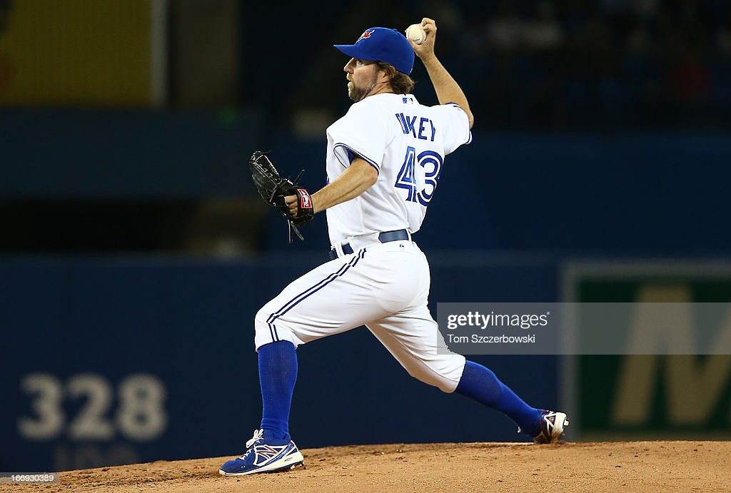 R.A. Dickey #43 of the Toronto Blue Jays delivers a pitch during MLB game action against the Chicago White Sox on April 18, 2013 at Rogers Centre in Toronto, Ontario, Canada.
