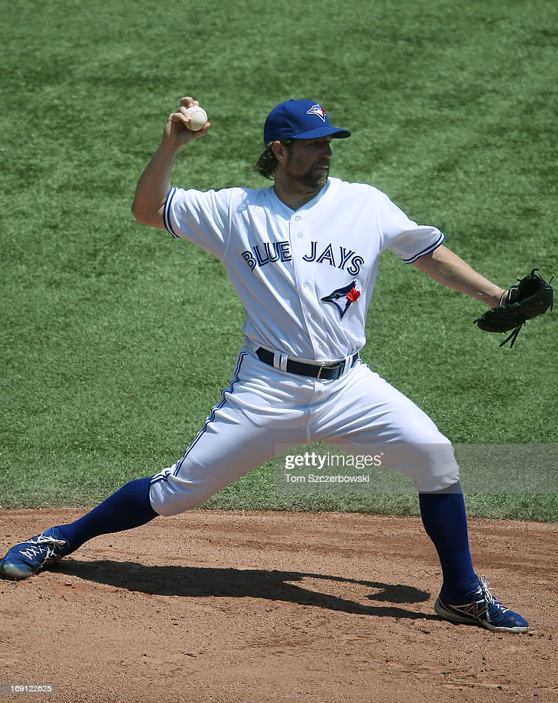 R.A. Dickey #43 of the Toronto Blue Jays delivers a pitch during MLB game action against the Tampa Bay Rays on May 20, 2013 at Rogers Centre in Toronto, Ontario, Canada.
