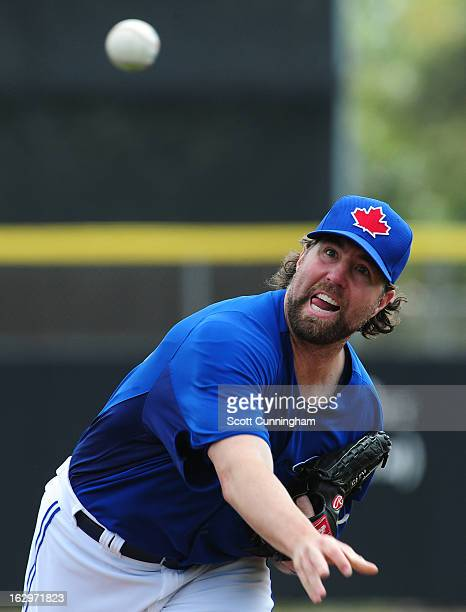 R A Dickey of the Toronto Blue Jays pitches during a spring training game against the Philadelphia Phillies at Florida Auto Exchange Stadium on March...
