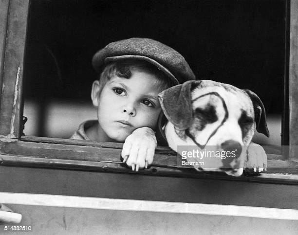 Dickie Moore and Pete the Pup start for location together while working in the 1932 film A Lad an' his Lamp the new Hal Roach Our Gang comedy