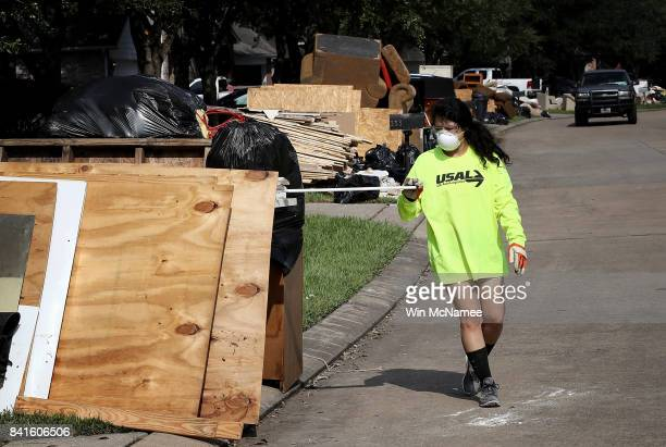 Dickinson residents discard possessions damaged by flooding brought on by Hurricane Harvey September 1 2017 in Dickinson Texas Dickinson was hit by...