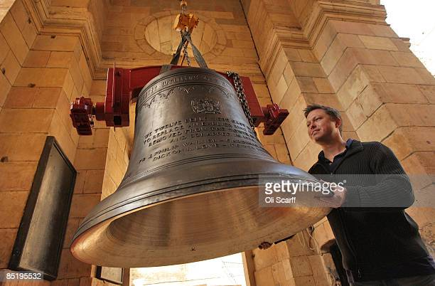 Dickon Love the Tower Keeper manoeuvres a bell into the church of St Magnus the Martyr on March 2 2009 in London The bell is one of a new ring of...