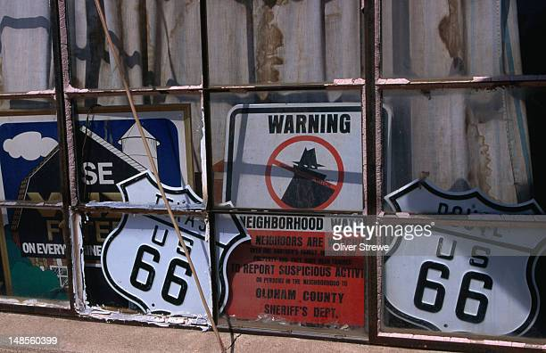 dick's garage, on the old route 66, has been in operation since 1943, and seems to have collected plenty of old road signs along the way. - 1943 stock pictures, royalty-free photos & images