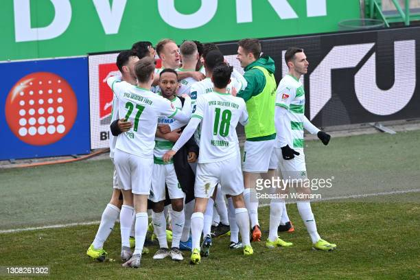 Dickson Abiama of SpVgg Greuther Furth celebrates with his team mates after scoring their side's second goal during the Second Bundesliga match...