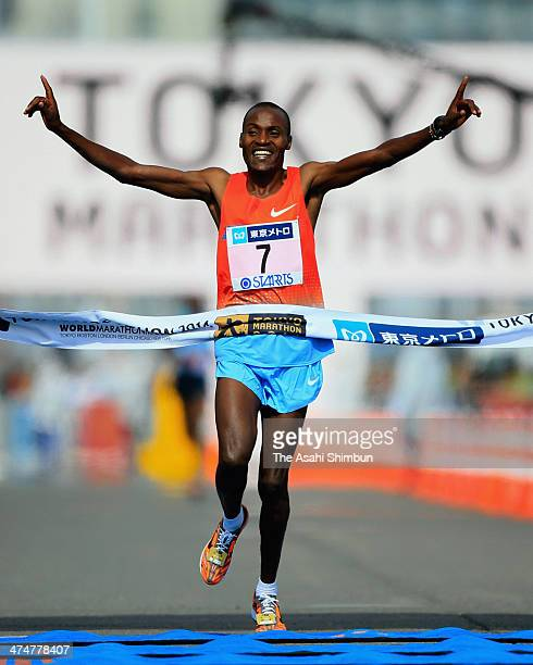 Dickson Chumba of Kenya crosses finishing line to win during the Tokyo Marathon 2014 on February 23 2014 in Tokyo Japan