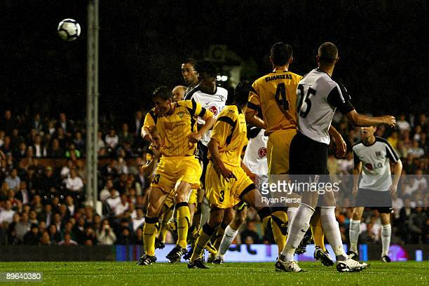 Dickson Etuhu of Fulham heads th first goal of the game during the UEFA Europa League Third Qualifying Round Second Leg match between Fulham and FK...