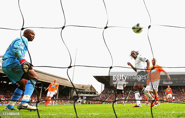 Dickson Etuhu of Fulham scores their third goal as goalkeeper Richard Kingson of Blackpool looks on during the Barclays Premier League match between...