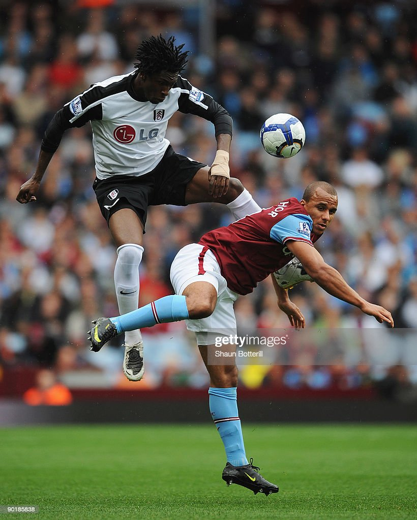 Dickson Etuhu of Fulham wins a header against Gabriel Agbonlahor of Aston Villa during the Barclays Premier League match between Aston Villa and Fulham at Villa Park on August 30, 2009 in Birmingham, England.