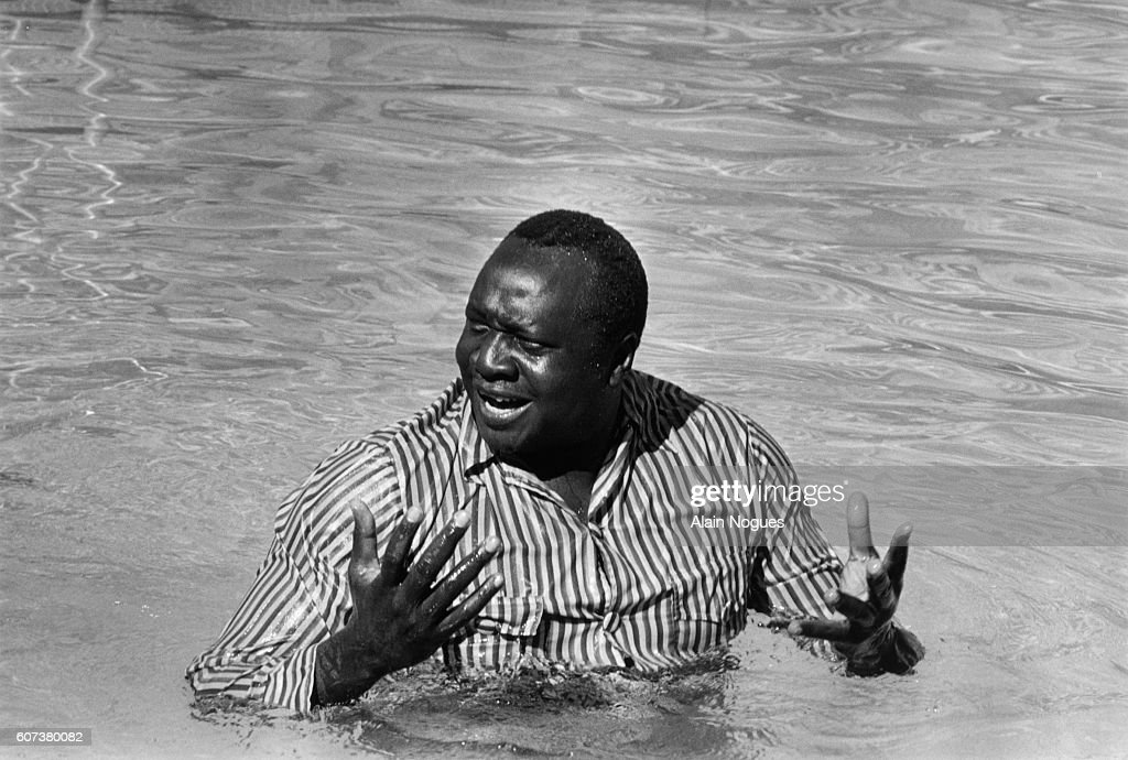Dictator Idi Ammin Dada bathes at the Hilton Hotel's swimming pool between two OUA sessions.