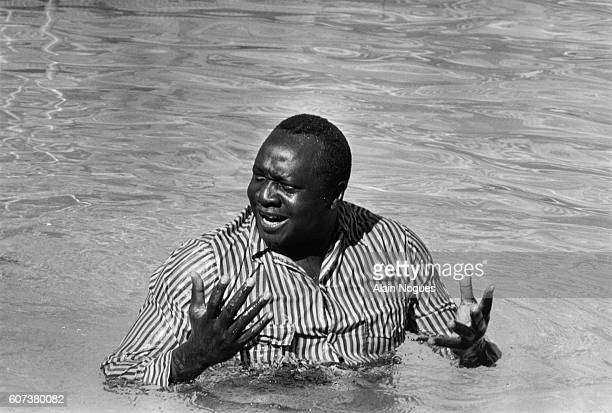Dictator Idi Ammin Dada bathes at the Hilton Hotel's swimming pool between two OUA sessions